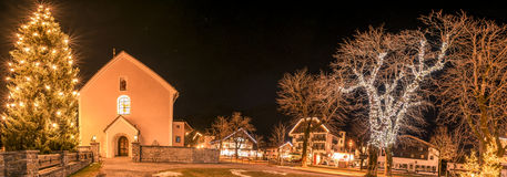 Winter night lights in an Austrian village Stock Photography
