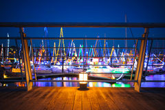 Winter night luminosity. Dimly lit of a laguna lamp, with yacht winter illumination in the background stock photo