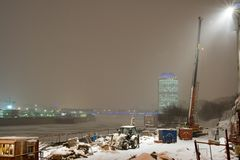 Winter night at Moscow. At first plane building site. At background foot-bridge and commercial edifice Stock Images
