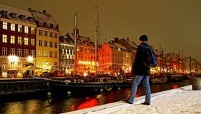 Winter night in Nyhavn in Copenhagen. Nyhavn in Copenhagen. Old houses, boats, man enjoying cold night Stock Photography