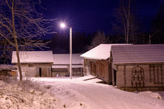 Winter night with old farm houses Royalty Free Stock Images