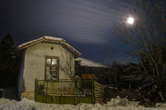 Winter night picture with old house Stock Photo