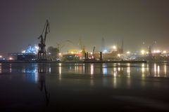 Winter at night in the port. Stock Photos