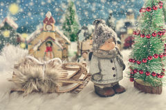 Winter night scene with a boy standing by the christmas tree Royalty Free Stock Photo