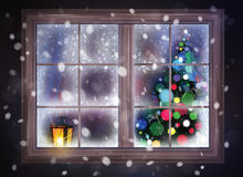 Winter night scene of window with Christmas tree and lantern. Stock Photography
