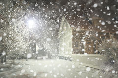 Winter night  street in city, snowfall. Stock Photos
