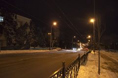 Winter. Night street with the tram rails royalty free stock images