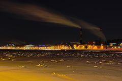 The winter night thermal power station on the Neva river embankment in Saint Petersburg stock photos