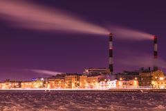 The winter night thermal power station on the Neva river embankment in Saint Petersburg stock photo