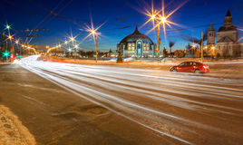 Winter night in Tula, Russia. Long exposure shot with traffic light trails. Arms museum and church от background Royalty Free Stock Image