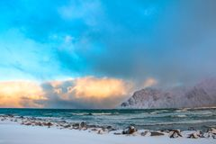 Winter Norway. Sea Surf and Colored Clouds Royalty Free Stock Photos