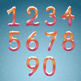 Winter numbers set with snow caps. Frozen New year digits with s. Nowflakes on it kit. Icicles numbers on dark snowy background Stock Image