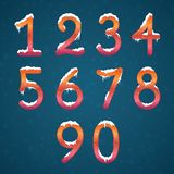 Winter numbers set with snow caps. Frozen New year digits with s. Nowflakes on it kit. Icicles numbers on dark snowy background Royalty Free Stock Images