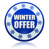 Winter offer on blue circle banner with snowflakes symbols Royalty Free Stock Photo