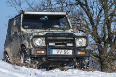 Winter Offroad. An offroad car is parking in the snow Stock Image