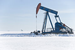 Winter Oil 1. The oil industry keeps on pumping even during the winter season Stock Image