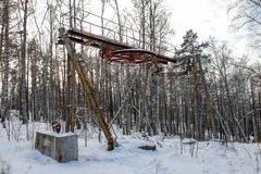 In winter in the mountain forest an old ski lift stock photos
