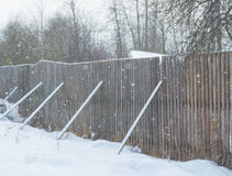 In winter, the old wooden fence with props Royalty Free Stock Image