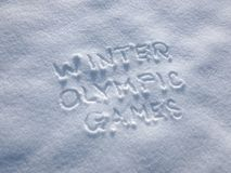 Winter Olympic Games - Writing In the Snow. Letters written on the snow surface. Frosty and sunny day Royalty Free Stock Photos