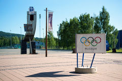 Winter Olympic statues and museum sign, Lillehammer, Norway Royalty Free Stock Photography