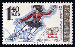 Winter Olympics in Innsbruck, Austria, circa 1976. MOSCOW, RUSSIA - JANUARY 7, 2017: A postage stamp printed in CZECHOSLOVAKIA shows figure skating in 1976 Stock Photography