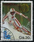 Winter Olympics in Lake Placid. RUSSIA KALININGRAD, 19 APRIL 2017: stamp printed by Paraguay, shows  Annemarie Moser-Proll, downhill skier at Winter Olympics in Royalty Free Stock Images