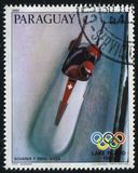 Winter Olympics at Lake Placid. RUSSIA KALININGRAD, 19 APRIL 2017: stamp printed by Paraguay, shows Scharon and Benz in the 2 man bobsled at Winter Olympics at Royalty Free Stock Photos