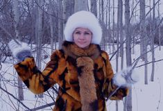 Winter one forest fun model happy people nature park clothing smiling face outdoor person fashion white coat winter woman snow fur Royalty Free Stock Images