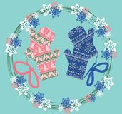 Winter ornamented gloves. In a floral wreath. Vector Christmas greeting card. Vintage Pastel blue and pink colors Royalty Free Stock Images