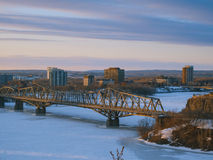 Winter in Ottawa. View from the Parliament Hill of the frozen river and bridge in Ottawa, Canada (with copy space stock image