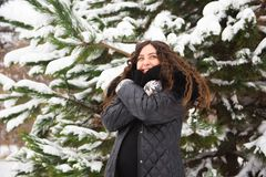 Winter outdoor portrait of pregnant woman in fashionable clothes. stock photo