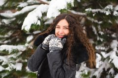 Winter outdoor portrait of pregnant woman in fashionable clothes. royalty free stock photography
