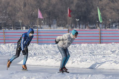 Winter outdoor skating enthusiasts Stock Images