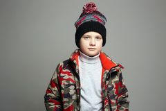 Winter outerwear. stylish teenager in hat royalty free stock image