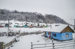 Winter over the roma houses in Viscri, Romania Royalty Free Stock Image