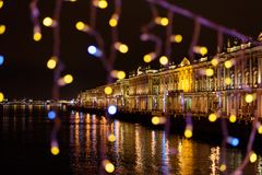Winter Palace view from Palace bridge decorated at night. Saint Petersburg. Russia Royalty Free Stock Photography