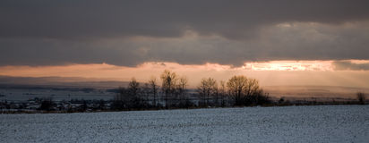 Winter panorama. Sunset winter country before snow storm Royalty Free Stock Photo