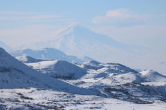 Winter panorama of Armenian mounatians with peak Ararat at the background. Fantastic winter panorama of the range of mountains with the peak of Ararat at the Stock Photography