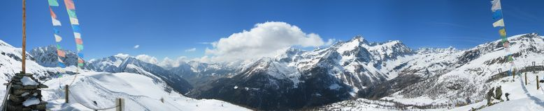 Winter panorama of base refuge. The sight from the campo base refuge in the courmayeur valley, on alps. really deep blue sky with soft clouds Royalty Free Stock Images