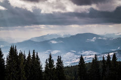 Winter panorama of the Carpathian mountains in the winter. Journey through Eastern Europe, Ukraine. Wild nature of the Carpathian mountains. Mountain valley in Stock Photos