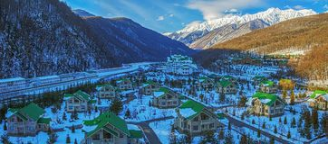 Winter panorama of the complex of cottages `Grand Hotel Polyana` is a mountain-tourist center near Sochi, Russia Royalty Free Stock Photography