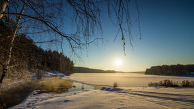 Winter panorama of frozen lake in a snowy forest with fog over the water, Russia, Stock Images