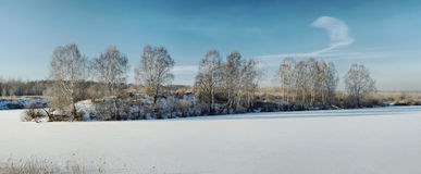 Winter panorama of a frozen pond Stock Photo
