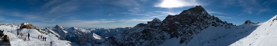 Winter Panorama Guglielmina. The sight from the guglielmina refuge in the olen valley, on alps. People skiing on slopes, a great winter sunny day Royalty Free Stock Photos