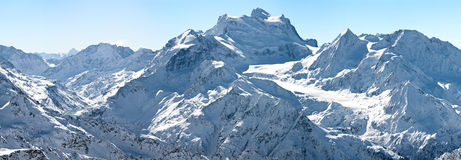 Winter panorama of high alpine mountains horizontal background Royalty Free Stock Image