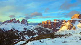 Winter panorama of high snowy mountains. Sunset, sunrise landscape of Alpes - european skiing resort Royalty Free Stock Photo