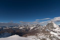 Winter panorama of mount Matterhorn covered with clouds, Canton of Valais stock image