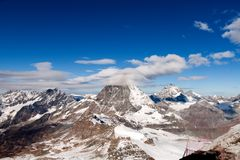 Winter panorama of mount Matterhorn covered with clouds, Canton of Valais stock photo