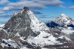 Winter panorama of mount Matterhorn covered with clouds, Canton of Valais, Alps Stock Image