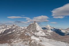 Winter panorama of mount Matterhorn covered with clouds, Canton of Valais royalty free stock image